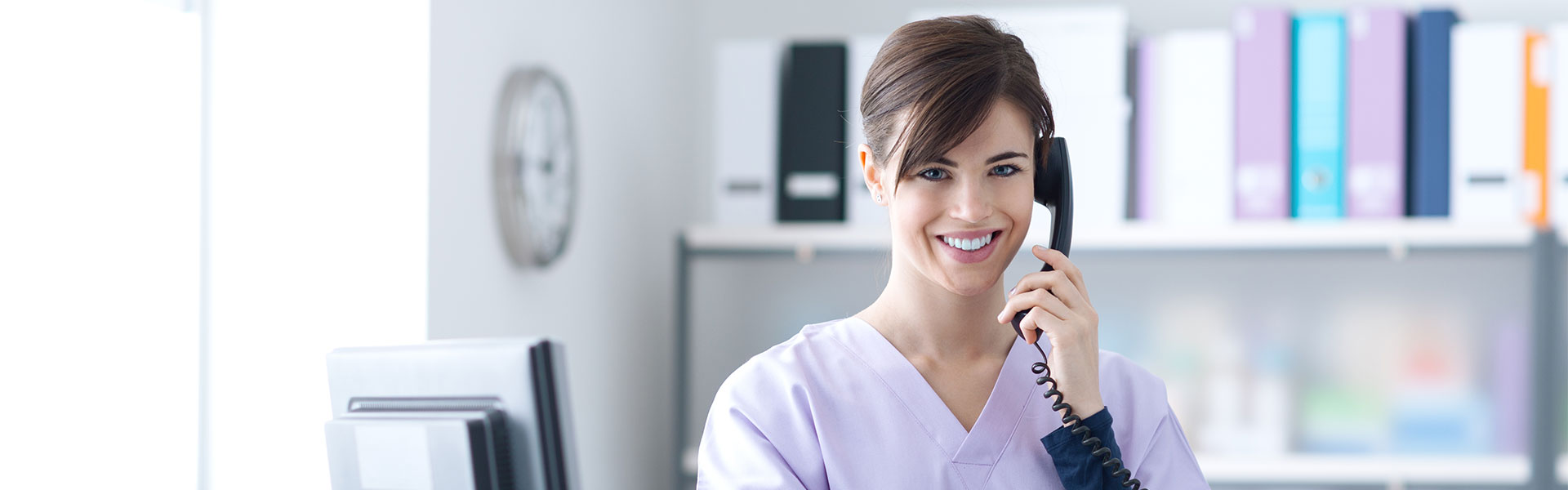 bigstock-Smiling-Receptionist-At-The-Cl-136924850